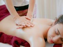 Woman having spa body massage treatment in the spa salon,Massage. And body care Stock Photo