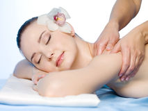 Woman having spa massage. Spa massage of shoulder of young beautiful woman - horizontal Stock Photography