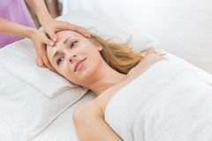 Woman having spa massage of her head Royalty Free Stock Photography