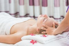 Woman having spa massage of her head. Young beautiful woman having spa massage of her head Royalty Free Stock Photos