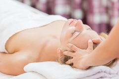 Woman having spa massage of her head. Young beautiful woman having spa massage of her head Stock Photography