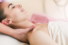 Woman having a spa treatment in beauty center. With soften hands on shoulders Stock Photography