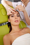 Woman having a stimulating facial treatment from a therapist Stock Photos