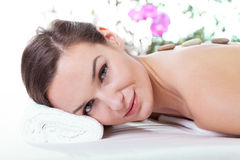 Woman having stone massage Royalty Free Stock Photo