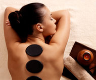 Woman having stone massage in spa salon. Young woman having stone massage in spa salon. Healthy lifestyle Royalty Free Stock Photography
