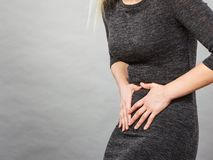 Woman having strong stomach ache. Syndroms Stock Photos