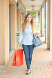 Woman having successful shopping trip Stock Photography