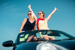 Woman having summer trip in convertible car Royalty Free Stock Photo