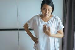 Woman having or symptomatic reflux acids,Gastroesophageal reflux disease stock image