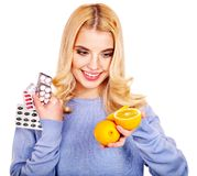 Woman having  tablets and lemon. Royalty Free Stock Image