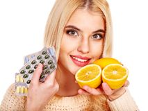 Woman having  tablets and lemon. Stock Images
