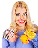 Woman having  tablets and lemon. Royalty Free Stock Photography