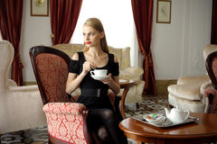 Woman having tea Royalty Free Stock Photo