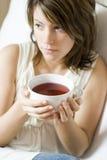 Woman having tea Royalty Free Stock Photography