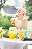 Woman having tea in garden