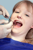 Woman having the teeth examined by the dentist. Royalty Free Stock Images