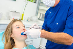 Woman having teeth moulded. Woman having her teeth moulded Royalty Free Stock Image