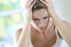 Woman having a terrible headache Royalty Free Stock Photography