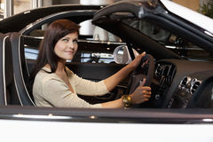 Woman having a test drive Royalty Free Stock Images