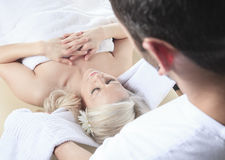 Woman having therapy massage Stock Photos