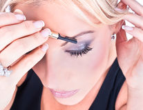 Woman having the touches applied to her make up Royalty Free Stock Photo