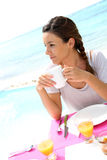 Woman having tropical breakfast Stock Photos