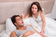 The woman having trouble with husband snoring Stock Image