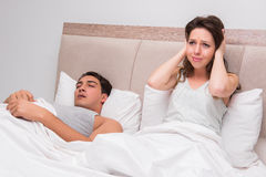 The woman having trouble with husband snoring Stock Photo