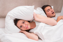 The woman having trouble with husband snoring. Woman having trouble with husband snoring Stock Image