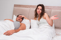 The woman having trouble with husband snoring Royalty Free Stock Photography