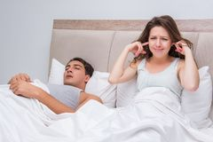 The woman having trouble with husband snoring. Woman having trouble with husband snoring Stock Photo