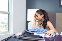 Woman having trouble packing Stock Photo