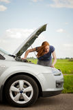 A woman having troubles with her car Stock Photos