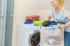 Woman holding laundry basket full of clothes royalty free stock photography