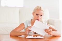 Woman having an unpleasant surprise Stock Images