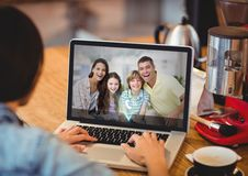 Woman having video call with family on laptop Royalty Free Stock Photos