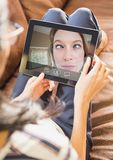 Woman having video call with friend on digital tablet. At home Royalty Free Stock Photography