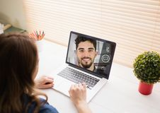 Woman having a video call with her colleague on laptop Royalty Free Stock Photo