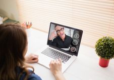 Woman having a video call with her friend on laptop Stock Image