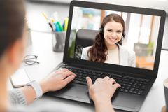 Woman having video call on laptop at office royalty free stock photography
