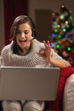 Woman having video chat with family in front of christmas tree Stock Photography