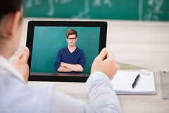 Woman having videochat on digital tablet Royalty Free Stock Photography