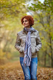 Woman having a walk in the woods Stock Photography