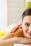 Woman having a wellness back massage Royalty Free Stock Images