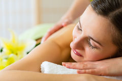 Woman having wellness back massage in spa Stock Photography