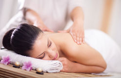 Woman having a wellness back massage stock images