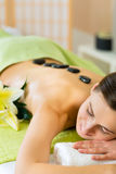 Woman having wellness hot stone massage Royalty Free Stock Photo