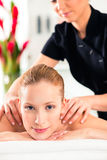 Woman having wellness massage in spa Royalty Free Stock Images
