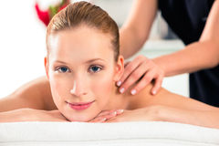 Woman having wellness massage in spa Royalty Free Stock Photo