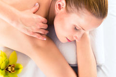 Woman having wellness massage in spa Royalty Free Stock Image